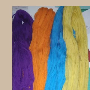 Picture of purple, orange, blue and yellow yarns on a table