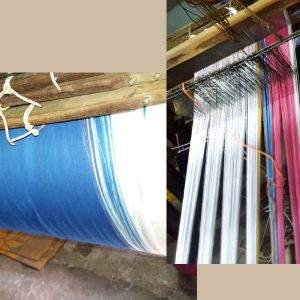 Different colors of yarns being processed on a weaving machine